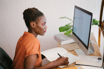 Black women in office at computer