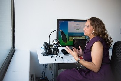 Women with microphone at laptop
