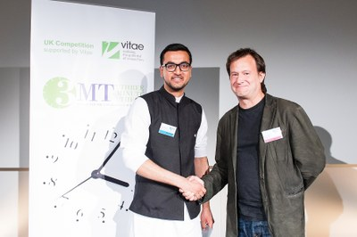Zaid Janjua, people's choice winner, receives his prize from Prof Bruce Hood of sponsor Speakezee