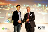 Iain Cameron, RCUK, presents the 2014 UK 3MT trophy to Richard Middlemiss of Glasgow University