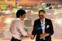 Rhys Anderson of Newcastle University receives the people's choice award from Ehsan Masood, editor of Research Fortnight
