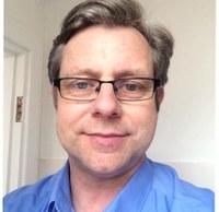 Dr Justin Hutchence