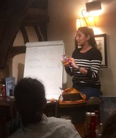 Shruti 2019 Winner presenting at PE event in a pub