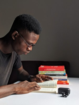 Black male studying a book