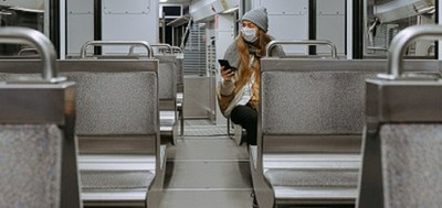 Female wearing mask on train